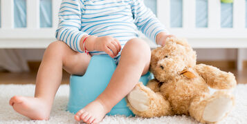 Cute,Toddler,Boy,,Potty,Training,,Playing,With,His,Teddy,Bear