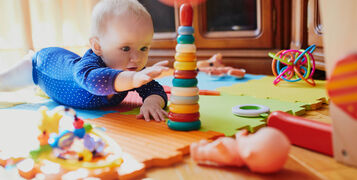 Baby,Girl,Playing,With,Toys,On,The,Floor.,Happy,Healthy